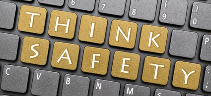 Golden think safety key on keyboard